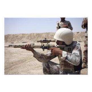 Las vistas iraquíes del sargento de ejército en ab arte fotográfico