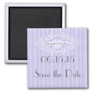 Las volutas y las cintas púrpuras ahorran la fecha iman