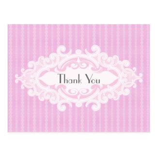 Las volutas y las cintas rosadas le agradecen postal