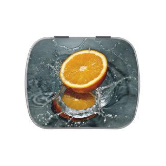 Latas anaranjadas del caramelo del chapoteo frascos de caramelos