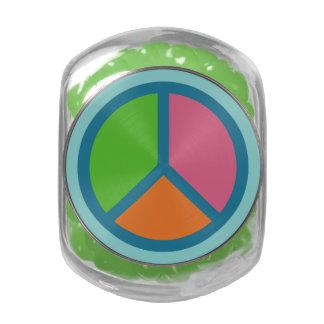 Latas y tarros coloridos del signo de la paz jarras de cristal jelly bely