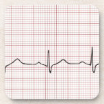 Latido del corazón en el papel cuadriculado, golpe posavasos