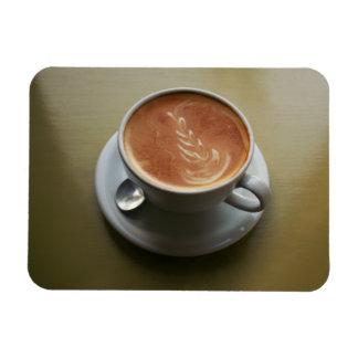 Latte on sunlit table magnet