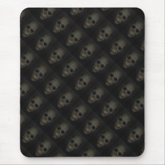 Laughing and staring skull mouse pad