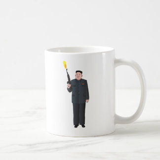 Laughing Kim Jong-un firing a gun into the air Coffee Mug