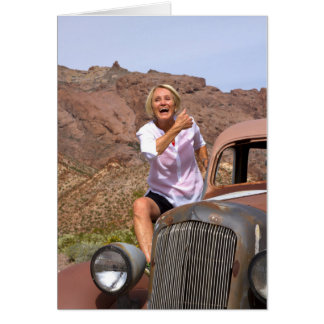 Laughing Retiree Riding Antique Car in the Desert Card