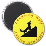 laughing wolf in moon 2 inch round magnet