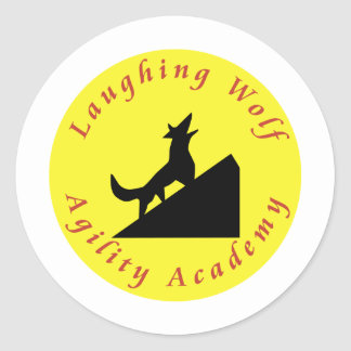 laughing wolf in moon classic round sticker