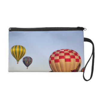 Launching hot air balloons 3 wristlet purses