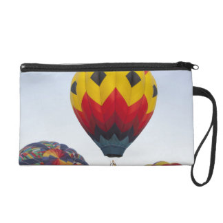 Launching hot air balloons wristlet clutches