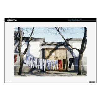 Laundry Drying on Clotheslines Laptop Skin