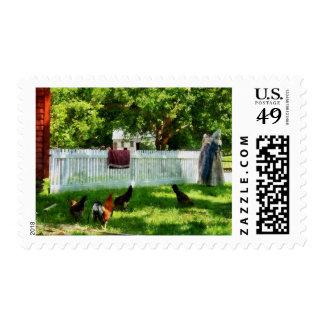 Laundry Hanging on Fence Postage