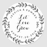"""Laurel Wreath Let Love Grow Wedding Favor Classic Round Sticker<br><div class=""""desc"""">Custom-designed circular wedding favor labels/stickers featuring &quot;Let Love Grow&quot; encircled in a hand-drawn laurel wreath. Personalize with bride and groom/couple&#39;s names and wedding date. Perfect for adding a touch of style to garden themed wedding favor/gift packagings,  envelopes,  and more!</div>"""