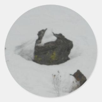 Lava rock in snow classic round sticker