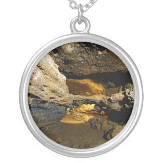 Lava tube cave round pendant necklace