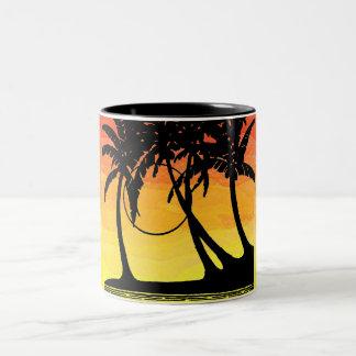 Lavado tropical de la puesta del sol tazas