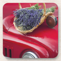 Lavender bunches rest on old farm pickup truck drink coaster