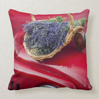 Lavender bunches rest on old farm pickup truck throw pillow