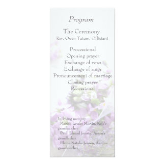 Lavender-colored flowers fade wedding program