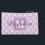 """Lavender Damask Clutch Cosmetic Bag with Monogram<br><div class=""""desc"""">This beautiful mini clutch purse or cosmetic bag features a classic white damask pattern over a lavender or dusty purple background. The design is personalized with a monogram initial letter as well as a customizable name giving it a simple yet elegant style. Great for carrying makeup or other personal items....</div>"""