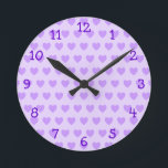 "Lavender Heart Pattern Wall Clock<br><div class=""desc"">Cute lavender purple girly heart pattern.</div>"