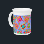 """Lavender Quilt Block Porcelain Pitcher<br><div class=""""desc"""">Original quilt art combines favorite quilt blocks plus unique blocks to form a quilt design with vibrant and dynamic colors on a periwinkle lavender background. Great for entertaining or everyday use, this pitcher is a great way to show off your love of quilting. This pitcher makes a great gift for...</div>"""