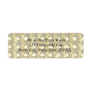 Lazos brillantes del oro etiquetas de remite