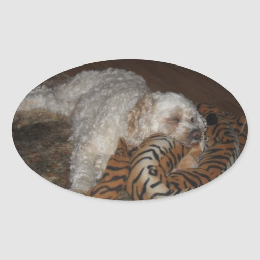 Lazy cockapoo dog on a tiger/zebra bed relaxing oval stickers