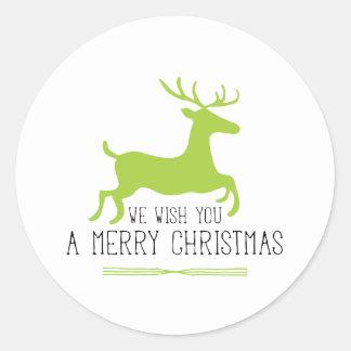 Le deseamos Felices Navidad el   reno verde Pegatina Redonda