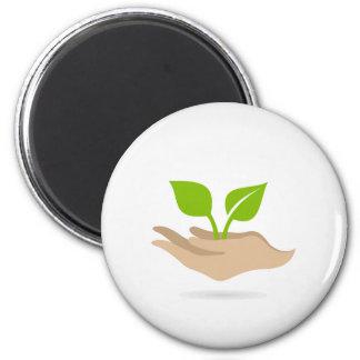 Leaf in hands magnet