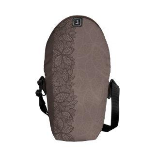 Leaf pattern border and background courier bag