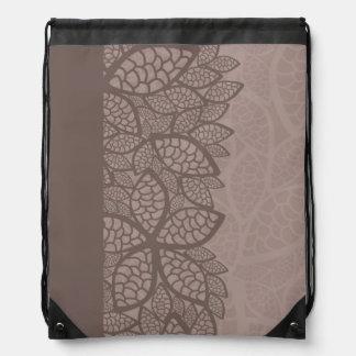 Leaf pattern border and background drawstring backpack