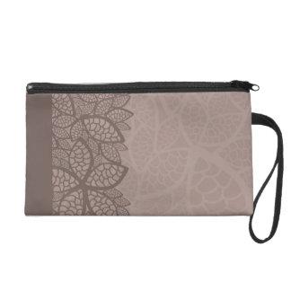 Leaf pattern border and background wristlet purse