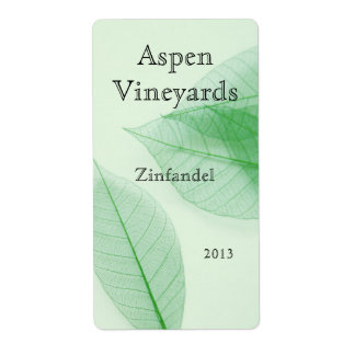 Leaf skeletons on pale green vertical wine label