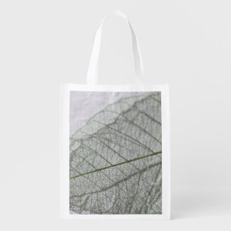 Leafy skeletons closeup grocery bag