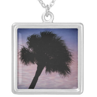 Leaning palm tree against cloudy sky square pendant necklace