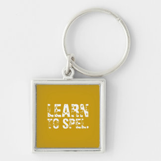 LEARN TO SPEL. white text Keychains