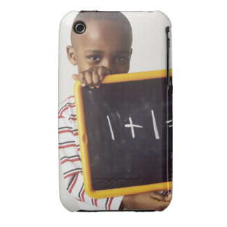 Learning arithmetic. 4-year-old boy holding a iPhone 3 cover