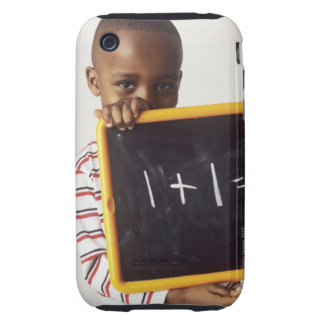 Learning arithmetic. 4-year-old boy holding a tough iPhone 3 cases