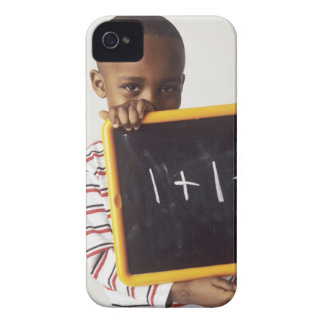 Learning arithmetic. 4-year-old boy holding a Case-Mate iPhone 4 cases