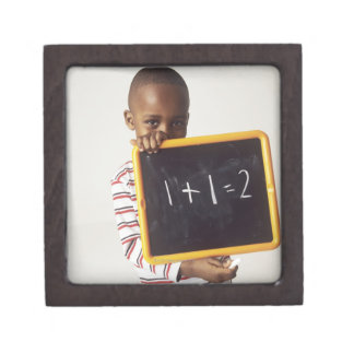 Learning arithmetic. 4-year-old boy holding a gift box