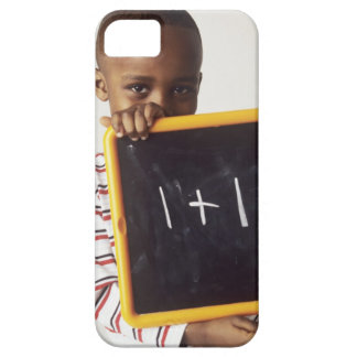 Learning arithmetic. 4-year-old boy holding a iPhone SE/5/5s case