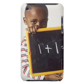 Learning arithmetic. 4-year-old boy holding a iPod touch case