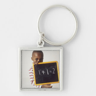 Learning arithmetic. 4-year-old boy holding a keychain