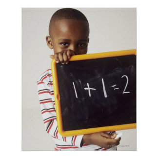Learning arithmetic. 4-year-old boy holding a poster