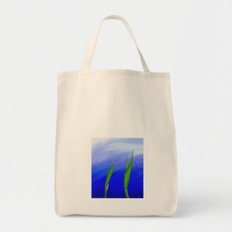 Leaves and a blue sky artwork tote bag