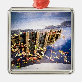 Leaves in a puddle square metal christmas ornament