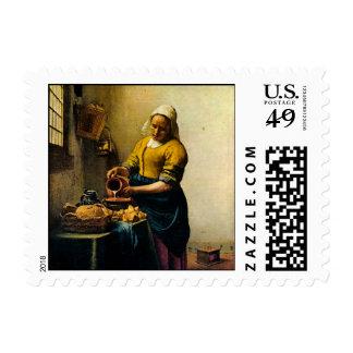 Leche de colada del Maidservant de Vermeer (circa Sellos