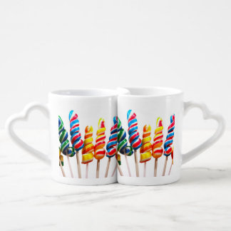 Lechones del caramelo del arco iris tazas para enamorados