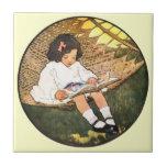 Lectura de la niña en una hamaca azulejos ceramicos